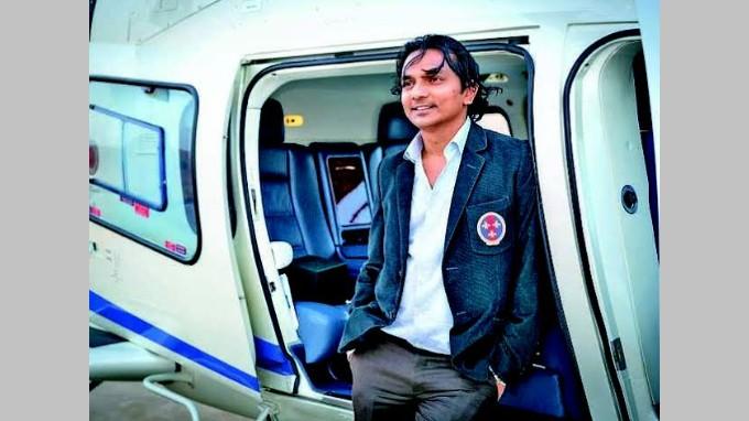 Divyank Turakhia Standing Near Helicopter