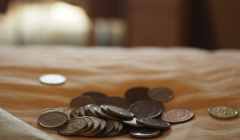 Coins On Table Showing The Affordability Of Digital Marketing Courses 1